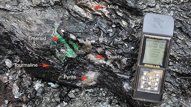 Emerald associated with black tourmaline, quartz, mica, and pyrite