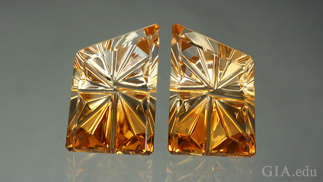 Two pieces of carved citrine that show light to dark from top to bottom.