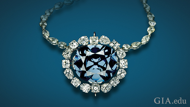 Image of the blue Hope Diamond in a setting surrounded by diamonds.