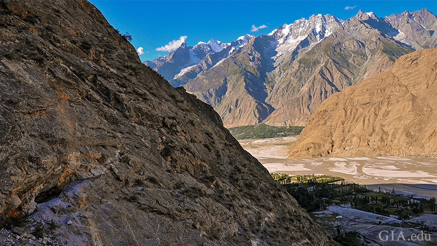 Landscape of Pakistan's Shigar Valley between steep mountains where the March birthstone aquamarine mines are found.