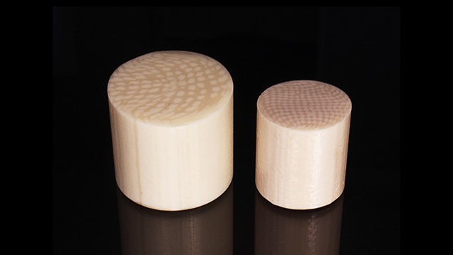 Two resin imitation ivory materials show parallel linear striations.