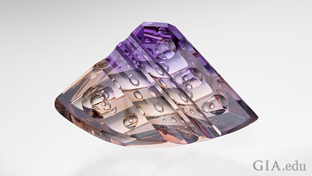 "A triangular shaped carved piece of ametrine with a rounded bottom. ""Bubbles"" of internal carvings can be seen."