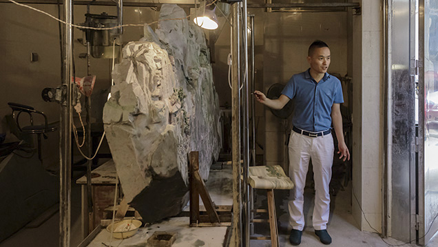 Jadeite carving artist Xingchun Fang and his work in progress