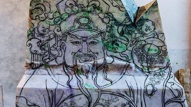 Close-up of sketch of Chinese god Lu on jadeite rough