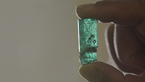 Emerald crystal with multi-phase inclusion