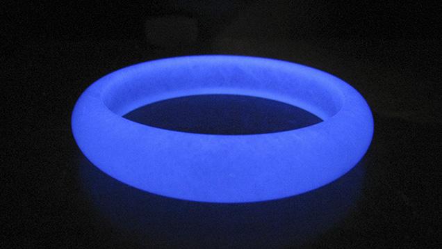 Polymer-impregnated aventurine quartz bangle under UV light