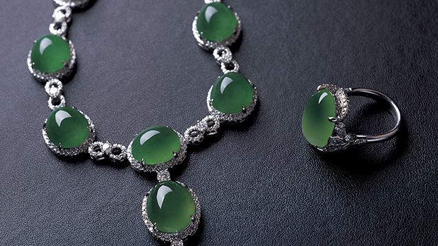 Jadeite cabochons mounted in karat gold with diamond accent stones