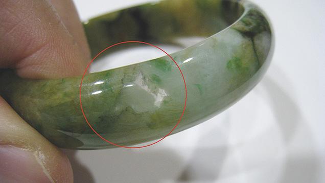 Jadeite bangle showing transparent area