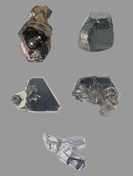 Several moissanite crystals