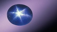 This blue sapphire displays a six-star asterism.