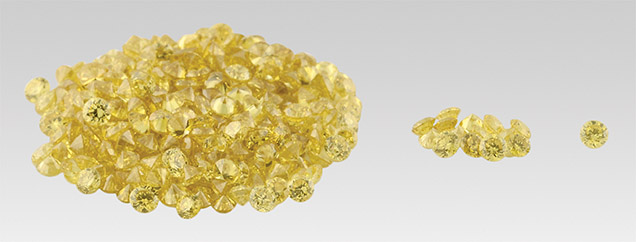 Group of intensely coloured round yellow diamonds
