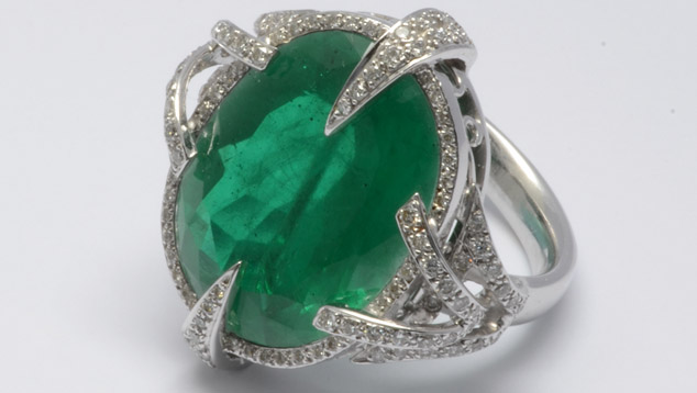 Beryl and topaz doublet resembling emerald