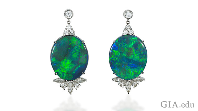 A pair of 18k white gold and black Australian opal and diamond earrings. The opal is 38.97cts.