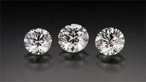 These three round brilliant diamonds, weighing 0.76, 0.82, and 0.74 ct (left to right), received Very Good cut grades. Each cut grade covers a range of proportions and can therefore have different appearances. Photo by Kevin Schumacher/GIA