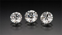 GIA Lab round brilliant diamonds. Left-to-right weight: 0.76, 0.82, 0.74 carats.