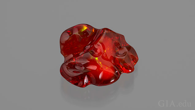 A free-form piece of orangey-red fire opal.