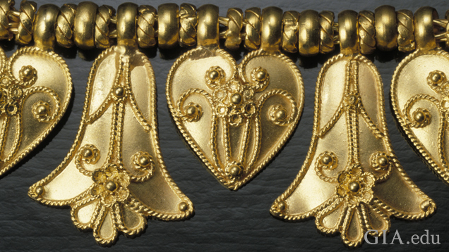 Detail of pendant elements heart and palmette shows twisted wire details (probably cast) and granulation soldered on.