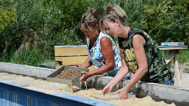 Two women washing gravel