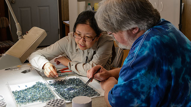 Man and woman checking sapphire colors
