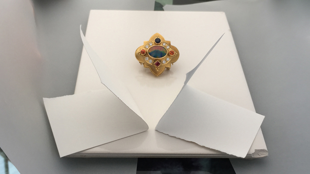 Image showing white cards bouncing light towards a jeweled brooch.