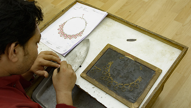 Jeweler making gold frame