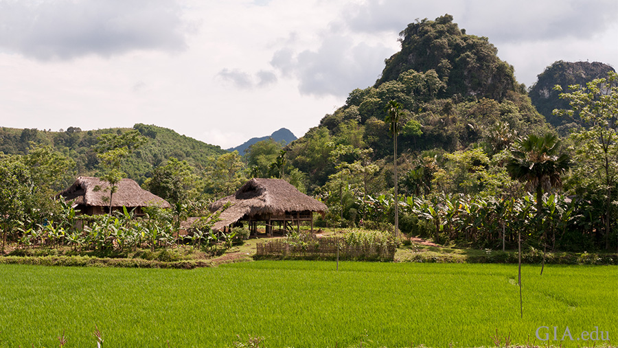 A small village sits at the base of the mountains in the ruby-bearing Luc Yen region. Photo: Vincent Pardieu/GIA