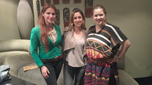 Three woman pose before a meeting.
