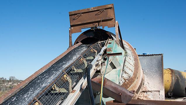 Tilted rotating barrel and conveyor belt