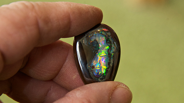 Hand holding boulder opal
