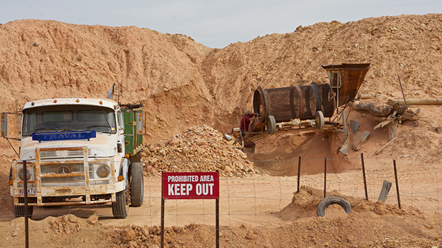 Trucks at boulder opal mining and processing site