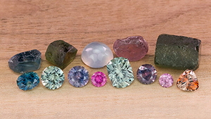 Rough and faceted sapphires of many colors