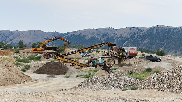 Equipment and piles of stones