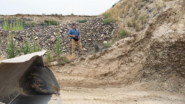 Man next to mining pit