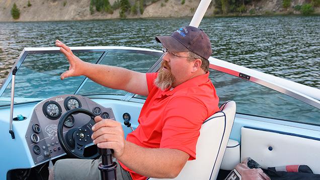 Man on boat talking