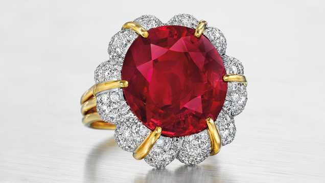 This ring features a 15.99 ct. oval-shaped Burmese ruby surrounded by diamonds and mounted in platinum and 18K gold.