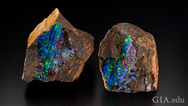 Blue, green and red flashes of color stand out in this pair of boulder opal specimens in matrix.