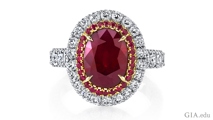 The 5.00 ct oval ruby in this designer ring is set in platinum with 18k rose gold, surrounded by halos of round rubies and diamonds. Courtesy: Omi Privé