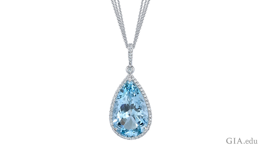 The March birthstone is the focal point of this necklace with a 10.06 carat pear shaped aquamarine surrounded by 72 round diamonds set in platinum.
