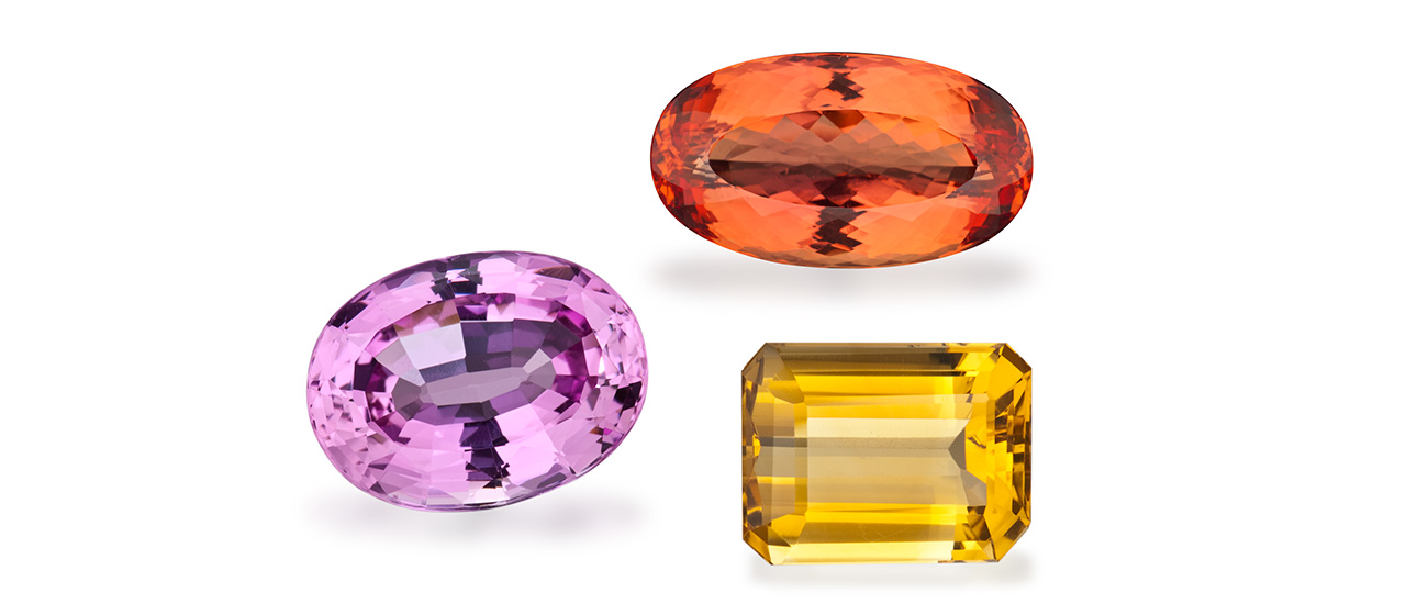 The two November birthstones are topaz (the pink and orange gems) and citrine (the yellow gem).