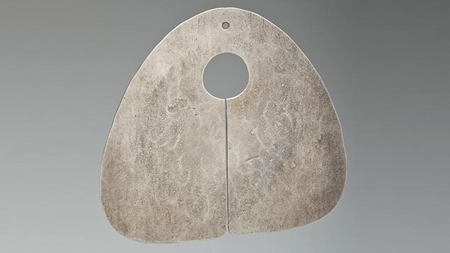"Silver ""Gong"" pendant by Bertoia."