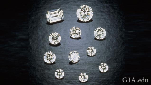 A group of 11 pieces of cut and polished moissanite. All round brilliants, except for one emerald cut.
