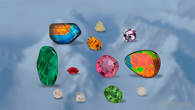 Multi-colored gems are superimposed on an image of glacier peaks.