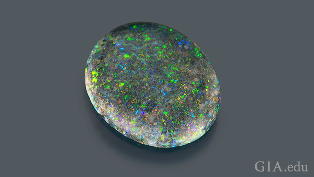 "A 1.7 ct oval opal with ""pinfire"" flecks of color."