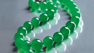 A jadeite necklace of graduated beads.