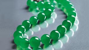 A jadeite necklace of graduated beads.
