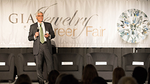 Image of GIA Governor Elliot Tannenbaum speaking at the Jewelry Career Fair