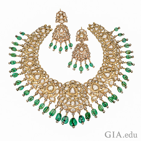 Image showing a necklace and two earrings with emeralds and diamonds and set in gold