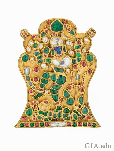 Gold Pendant of India god Shiva showing ruby, emerald, diamond, blue sapphire and cat's eye chrysoberyl gems.