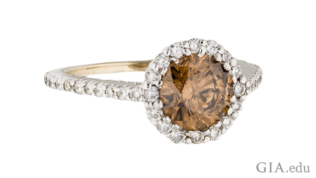 Image of white gold ring with brown diamond center stone surrounded by halo of white diamonds