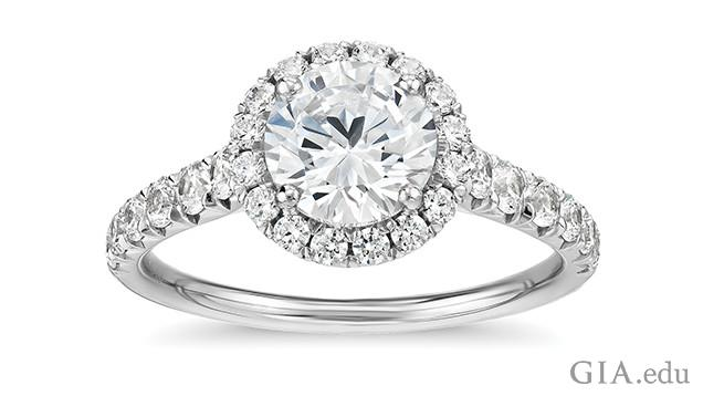 Image of engagement ring showing a single diamond surrounded by a halo of melee diamonds.